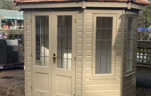 Side view of the Sunningdale 1.8 x 2.5m Wiveton Summerhouse painted in Taupe