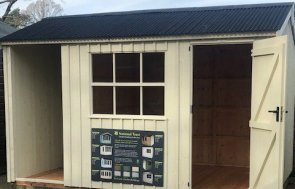 Sunningdale Blickling Shed 2.4 x 3.6m with open door painted in National Trust Dome Ochre