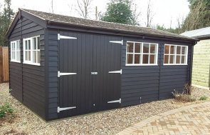 Side profile of the Cranleigh 3.6 x 5.4m Superior Shed with black door and ivory windows