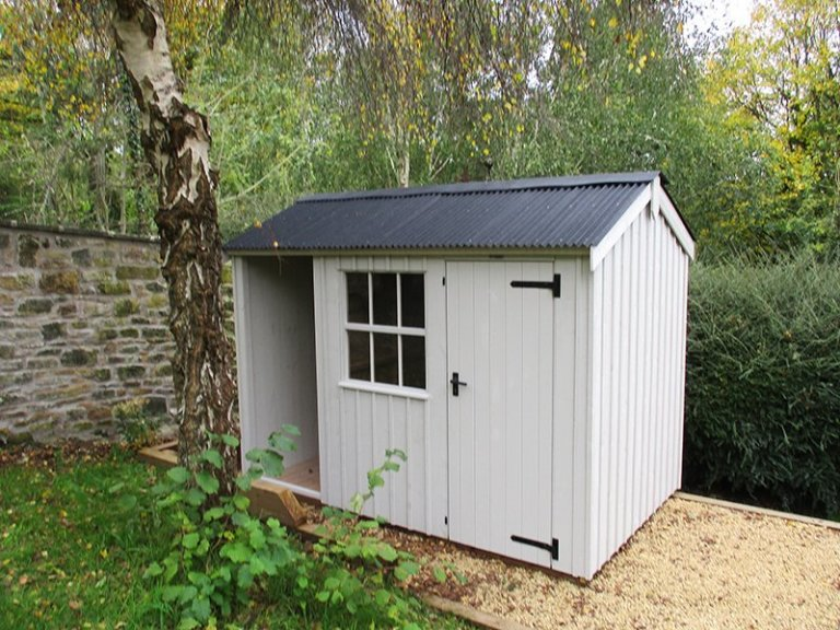 1.8 x 3.0m Blickling National Trust Shed painted in Earls Grey with apex roof design and built-in log store