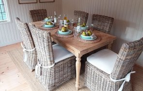 Table and chairs inside the Holkham Summerhouse at Cranleigh measuring 3.0 x 4.2m