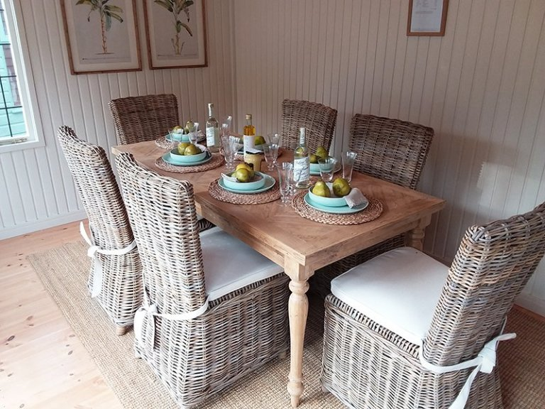 Table and chairs inside the Holkham Summerhouse at Cranleigh