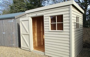 St Albans 1.8 x 2.4m Weatherboard Superior Shed with open door painted in Taupe from our exterior paint system