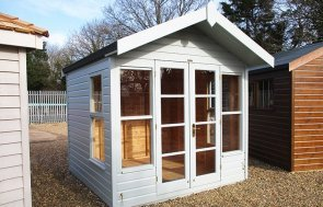 St Albans 2.4 x 2.4m Blakeney Summerhouse painted in Verdigris from our exterior paint system
