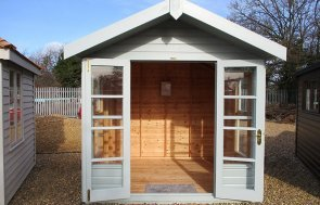 St Albans 2.4 x 2.4m Blakeney Summerhouse with open doors painted in Verdigris from our exterior paint system