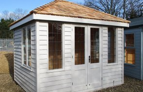 St Albans 2.4 x 3.0m Cley Summerhouse painted in Twine from our exterior paint system