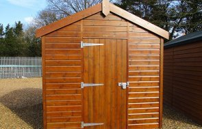 2.4 x 3.0m Sikkens Walnut Superior Shed at St Albans with an apex roof and shiplap cladding