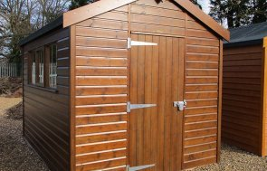St Albans 2.4 x 3.0m Sikkens Walnut Superior Shed with an apex roof and shiplap cladding