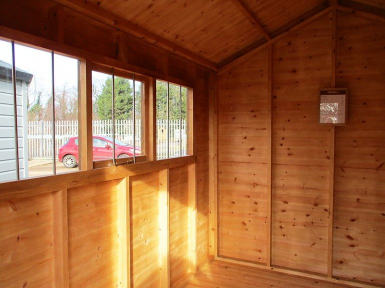 Inside the St Albans 2.4 x 3.0m Sikkens Walnut Superior Shed with an apex roof and shiplap cladding