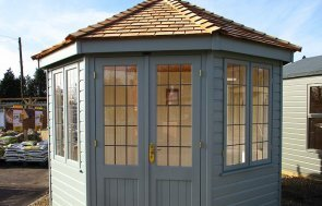 3.0 x 3.0m Wiveton Summerhouse at St Albans painted in Sage from our exterior paint system