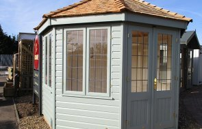 St Albans 3.0 x 3.0m Wiveton Summerhouse painted in Sage from our exterior paint system