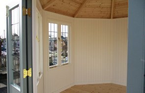 Inside the St Albans 3.0 x 3.0m Wiveton Summerhouse painted in Sage from our exterior paint system