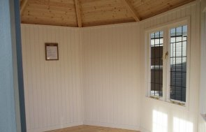 Interior shot of the St Albans 3.0 x 3.0m Wiveton Summerhouse painted in Sage from our exterior paint system