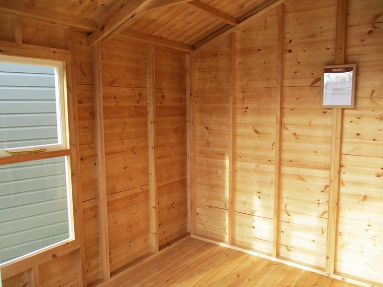 Inside the St Albans 3.0 x 3.6m Morston Summerhouse painted in Cream from our exterior paint system