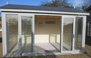 Our St Albans show centre 3_0 x 4_2m Burnham Studio with open double doors painted in Pebble from our exterior paint system