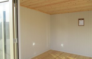 Inside the 3.0 x 4.8m Salthouse with Storage Partition painted in Taupe from our exterior paint system at St Albans