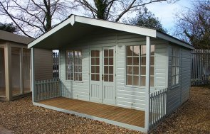Our St Albans show site 4.2 x 4.2m Morston Summerhouse painted in Sage from our exterior paint system