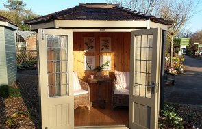 1.8 x 2.5m Wiveton Summerhouse at Cranleigh with open double doors painted in Taupe