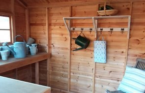 Inside the Cranleigh 2.4 x 3.0m Weatherboard Superior Shed in Farrow & Ball Pigeon