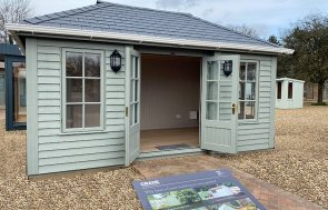 3.0 x 4.8m Garden Room in Farrow & Ball Pigeon with open double doors at St Albans