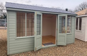3.0 x 4.2m Holkham Summerhouse painted in Lizard at our St Albans show site with open double doors