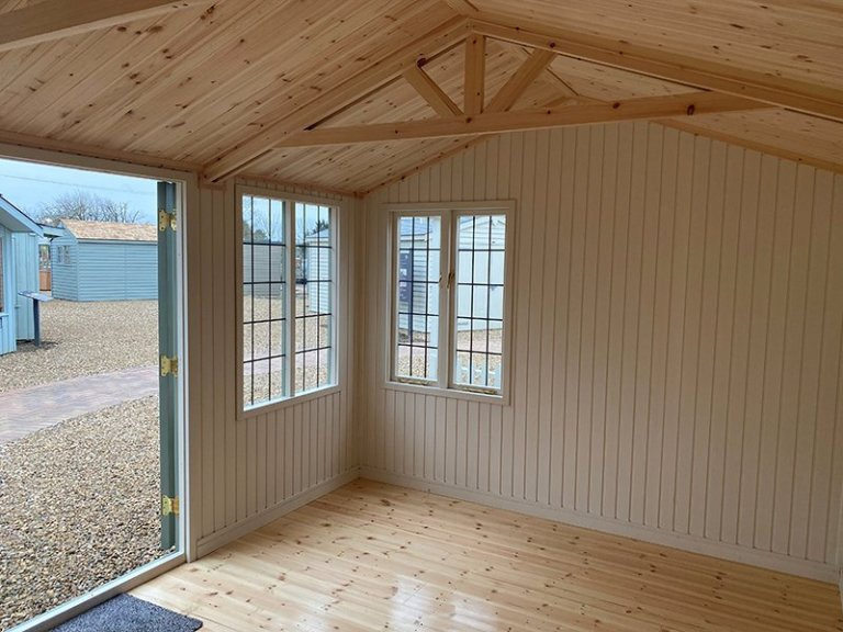 Inside the 3.0 x 4.2m Holkham Summerhouse painted in Lizard at our St Albans show site