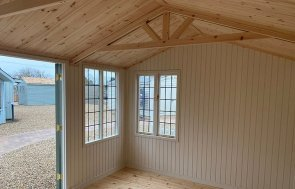 Interior of the 3.0 x 4.2m Holkham Summerhouse painted in Lizard at our St Albans show site