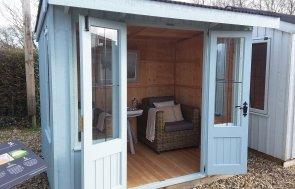 1.8 x 2.4m Brighton Flatford Summerhouse painted in Painters Grey