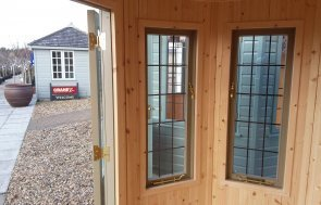 Leaded windows inside the Brighton 1.8 x 2.5m Wiveton Summerhouse painted in Taupe