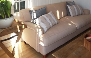 Sofa inside the dressed Brighton Cley Summerhouse measuring 3.0 x 3.6m