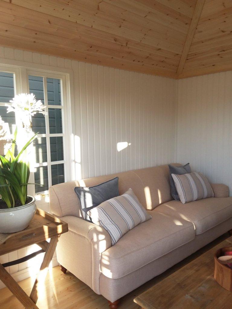Sofa inside the dressed Brighton Cley Summerhouse
