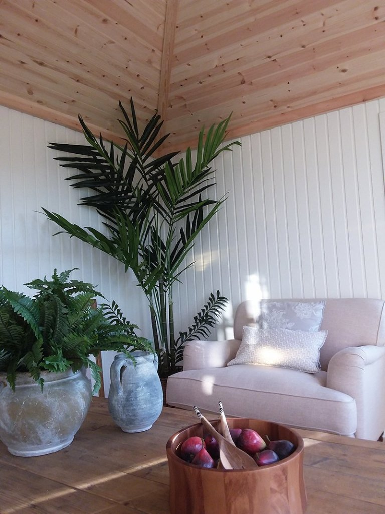 Relaxing lounge setting inside the dressed Brighton Cley Summerhouse