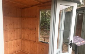 Inside the doors of the National Trust Flatford Summerhouse Sunningdale  measuring 1.8 x 2.4m