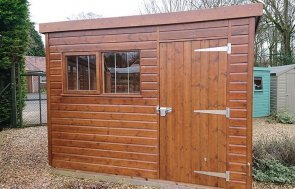 Sikkens Walnut Superior Shed at Newbury measuring 1.8 x 3.0m