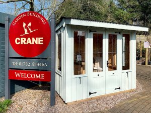 A National Trust Flatford Summerhouse at our Trentham Show Centre with a Welcome to Crane Sign March 2020