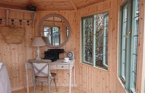 Interior of the Newbury 3.0 x 3.0m Wiveton Summerhouse painted in Lizard from our exterior paint system