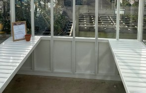 Workbenches inside the St Albans Ivory painted Greenhouse measuring 2.4 x 3.0m