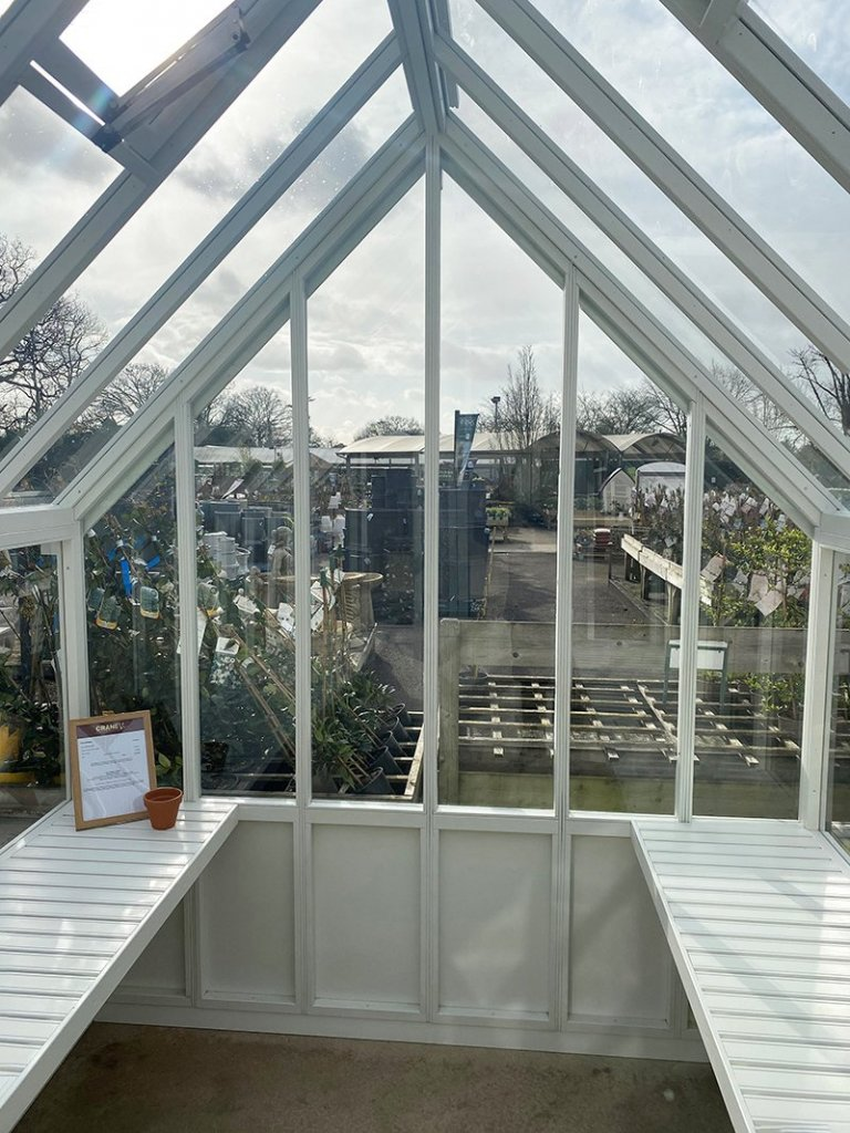 Workbenches inside the St Albans Ivory painted Greenhouse
