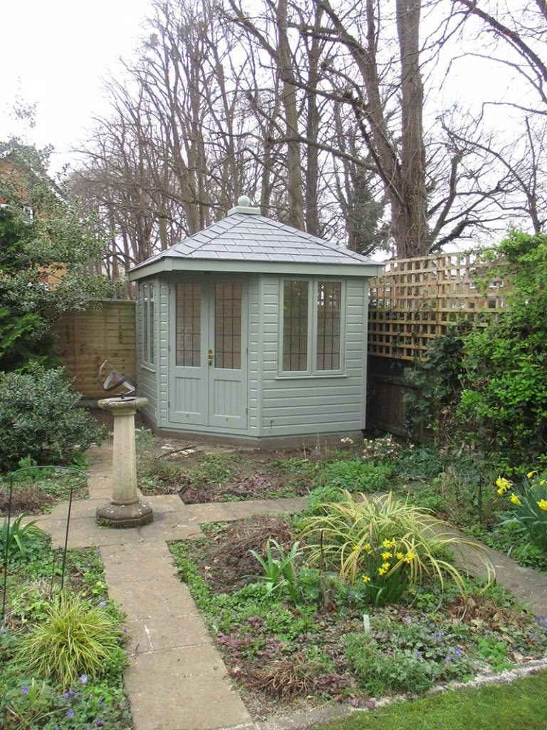 2.4 x 2.4m Fully Lined and Insulated Weybourne Summerhouse painted in Lizard from our Exterior Paint System