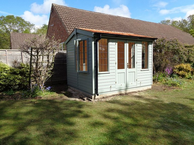 2.4 x 3.0m Fully Lined and Insulated Holkham Summerhouse painted in Sage from our Exterior Paint System