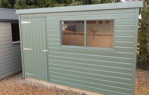 Burford 1.8 x 3.0m Classic Shed painted in Moss from our Classic Paint System