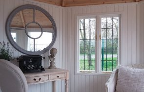 Interior of the 3.6 x 3.6m Dressed Wiveton Summerhouse at Brighton painted in Cream from our exterior paint system