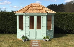 Classic Summerhouse in painted in Seagrass with plain windows and cedar shingle roofing tiles