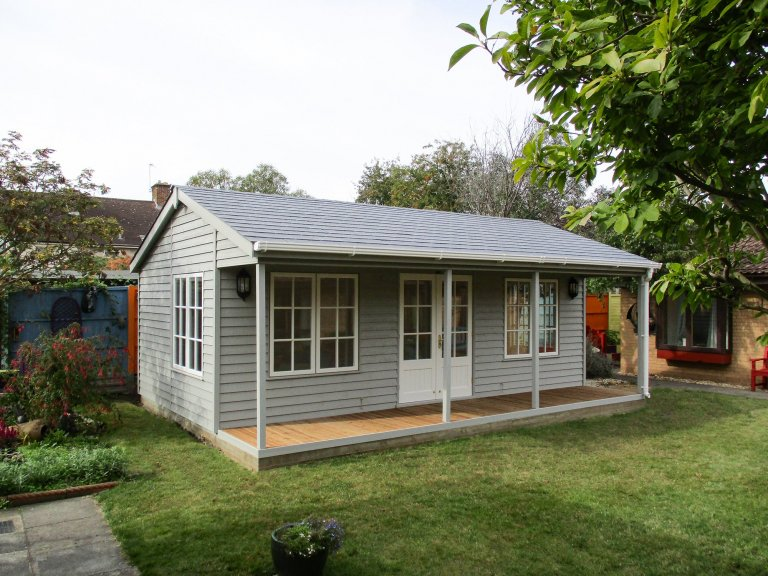 4.8 x 6.6m Pavilion Garden Room without the picket fence painted in Pebble and Ivory
