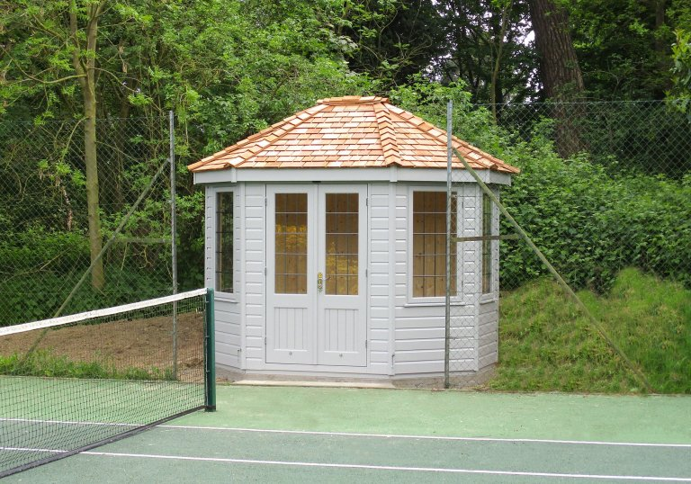 2.4 x 3.0m Wiveton Summerhouse next to a tennis court painted in Exterior Pebble