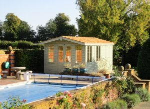 3.0 x 5.4m Blakeney Summerhouse with Storage Partition painted in Exterior Lizard