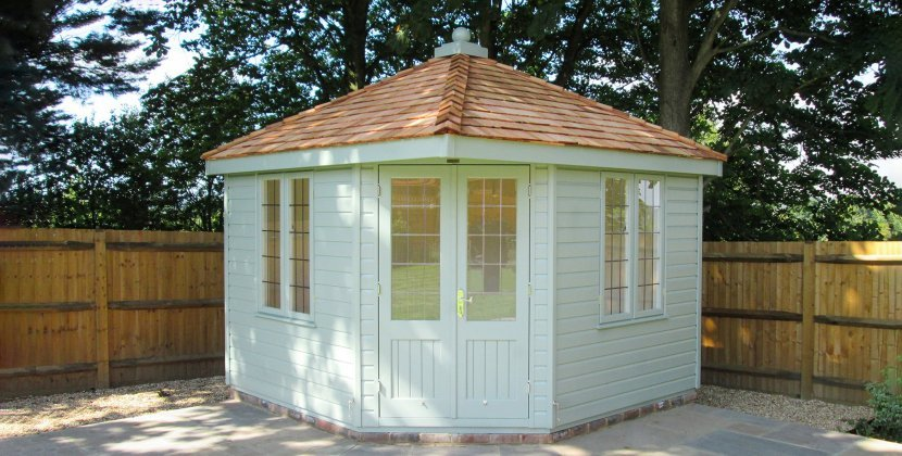 3.0 x 3.0m Weybourne Summerhouse painted in Exterior Sage with Cedar Shingle Roofing Tiles