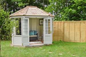 2.4 x 3.0m Octagonal Summerhouse painted in Classic Cotton, inside and out