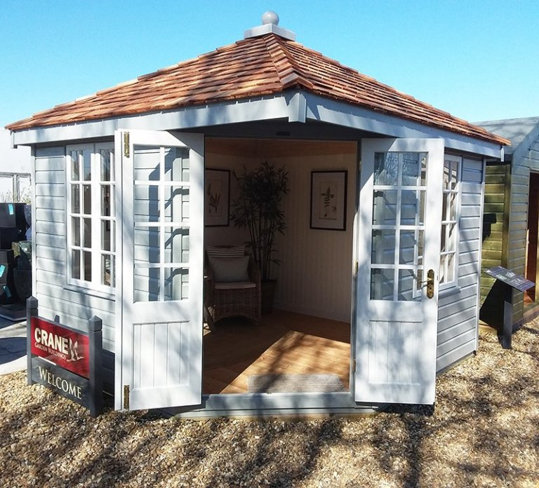 3.0 x 3.0m Weybourne Summerhouse at Brighton with open double doors painted in two-tone exterior Pebble & Ivory