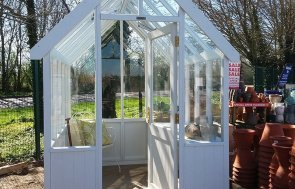 1.8 x 2.4m Greenhouse at Brighton with open door painted in Exterior Ivory